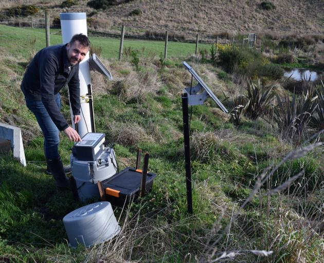 AgResearch Invermay senior scientist Richard Muirhead programmes an automatic water sampler in a...