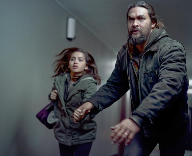 Jason Momoa and Isabela Merced in a scene from Sweet Girl. PHOTO: EPK/NETFLIX