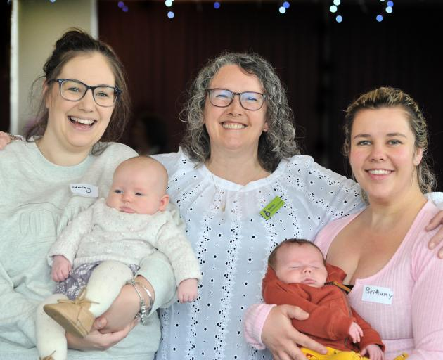 Celebrating 10 years of breast-feeding support in Dunedin are (from left) Stacey Schoester, with...