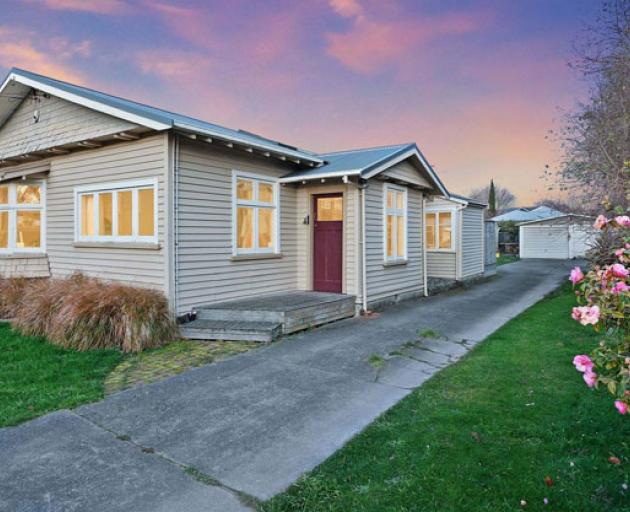 """A Papanui bungalow sold """"as is"""" fetched more than $1m at auction. Photo: Supplied"""