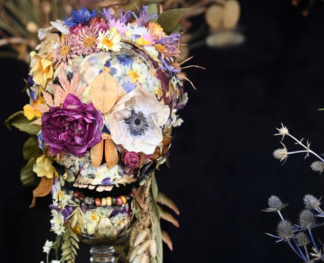 A dried flower arrangement forms a human skull at the 2021 Chelsea Flower Show.