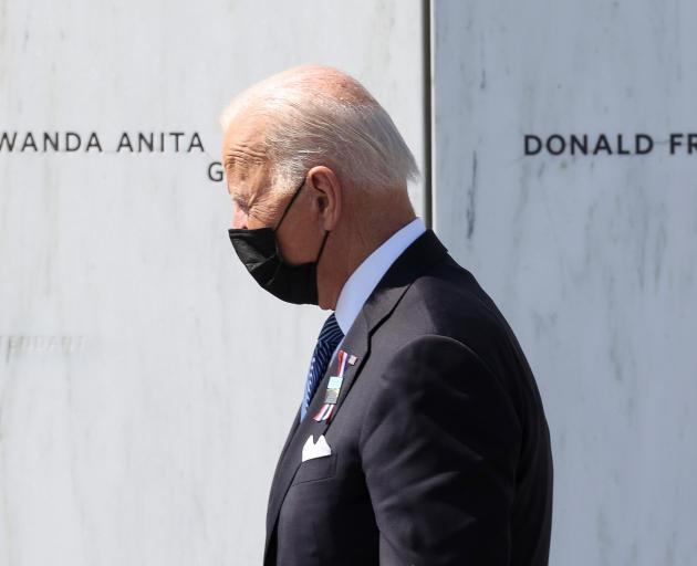 US President Joe Biden at a memorial service for victims of the September 11 attacks at the...