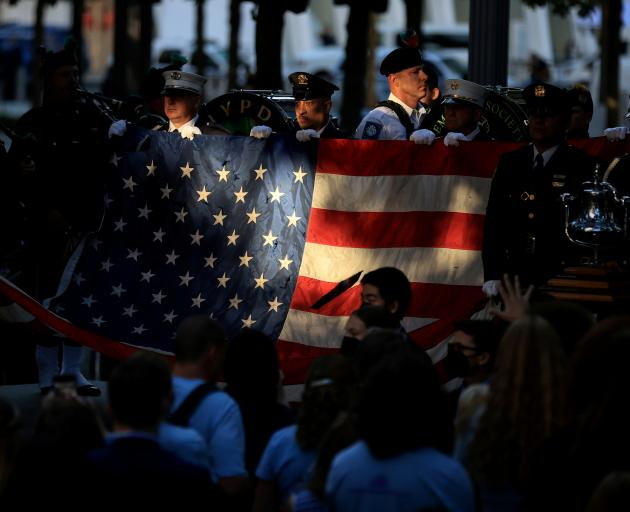 Members of the New York Police and Fire Department attending the memorial service marking 20...