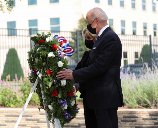 US President Joe Biden and first lady Jill Biden lay a wreath at the Pentagon, also a site of the...