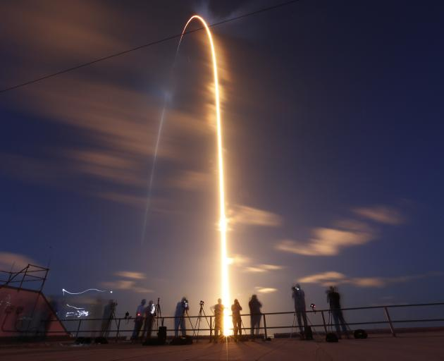 The Inspiration 4 civilian crew aboard a Crew Dragon capsule and SpaceX Falcon 9 rocket launches...