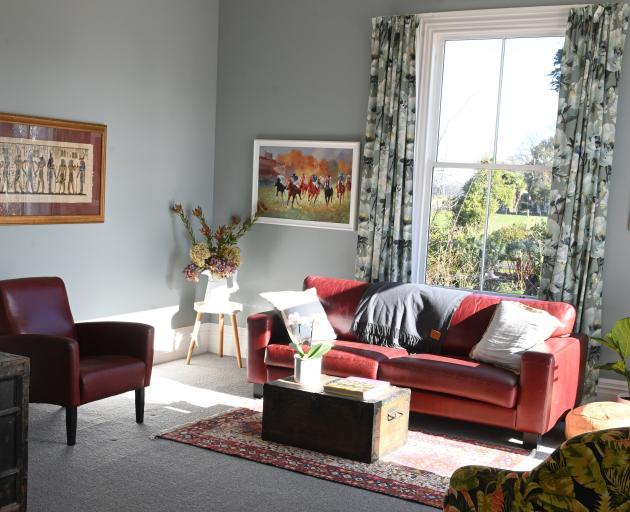 Just off the open-plan living area, a former bedroom became a lounge. PHOTO: LINDA ROBERTSON