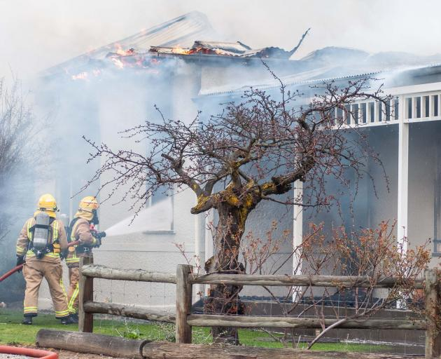 Fire crews fight to keep the blaze at the The Bank Ophir bed and breakfast under control...