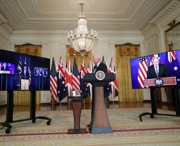 US President Joe Biden at the White House was joined virtually by Australian Prime Minister Scott...