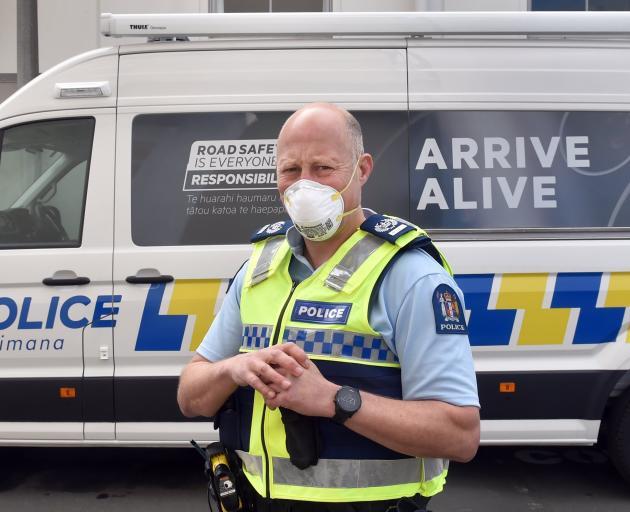 Senior Sergeant Nik Leigh, of Dunedin, shows off the city's new booze bus. PHOTO: PETER MCINTOSH...