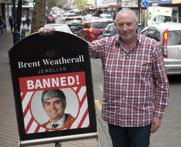 Brent Weatherall, a George St retailer, makes clear how he feels about the Dunedin City Council's...