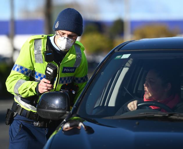Carrying out a breath test at a checkpoint in Crawford St in Dunedin yesterday is Constable...