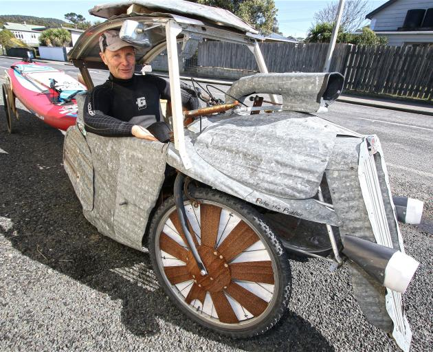 Kaka Point stand›up paddleboarder and corrugated iron sculptor Tony Somerville with the home›built pedal car he uses to transport his 3m paddleboard down the beach. PHOTO: JOHN COSGROVE