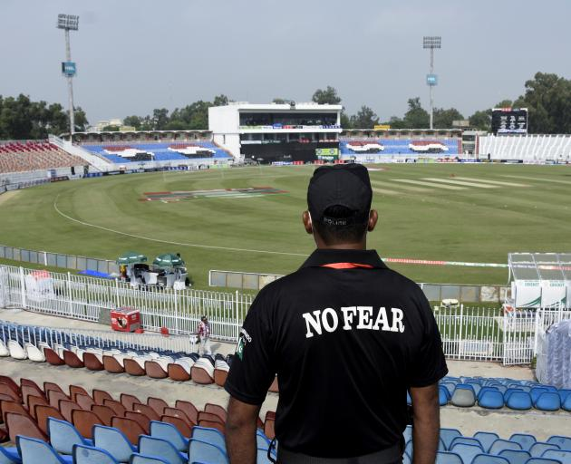 A member of the Police Elite Force stands guard at the Rawalpindi Cricket Stadium, after the New Zealand cricket team pulled out of a Pakistan cricket tour over security concerns. Photo: Reuters