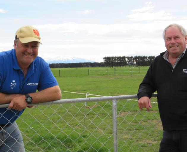 Craig Wiggins (left) catches up with Bruce Taylor, of Farmlands, over the farm gate. PHOTO TONI...
