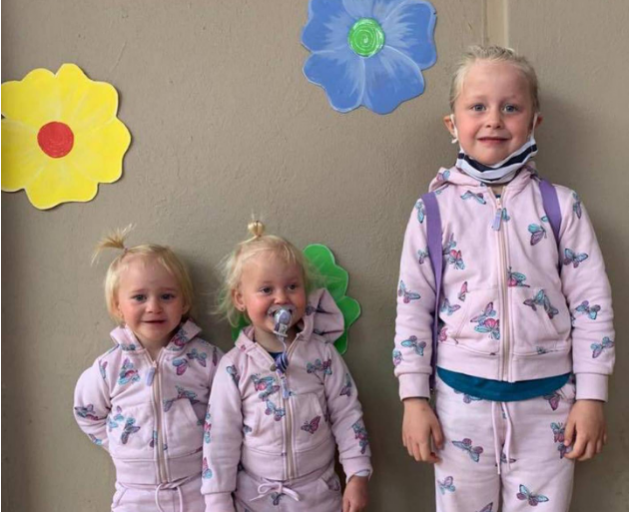 A woman has been charged after 2-year-old twins Karla and Maya Dickason and their 6-year-old...