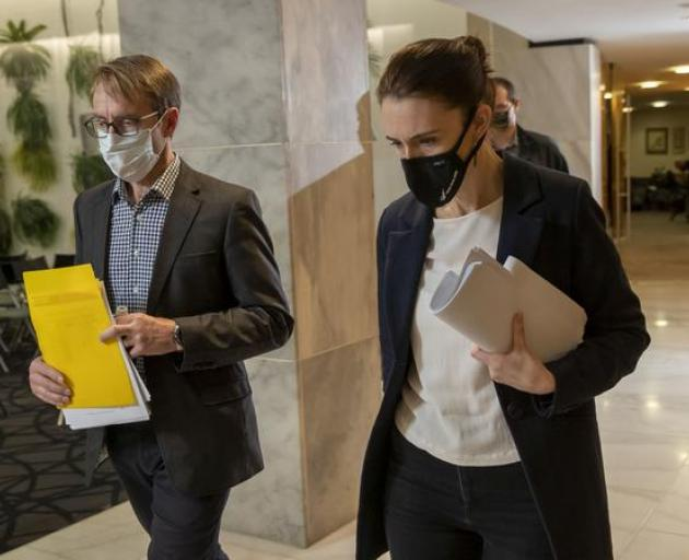 A masked-up Ashley Bloomfield with Prime Minister Jacinda Ardern. Photo: Pool / NZME