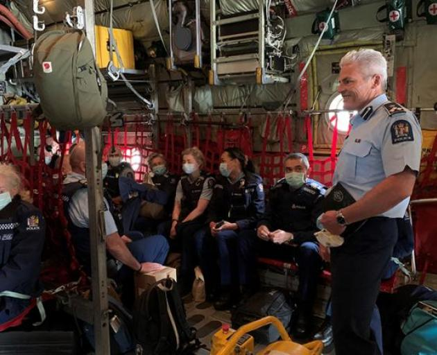Assistant Commissioner Richard Chambers addresses the team before take-off from Ohakea. Photo: NZ...