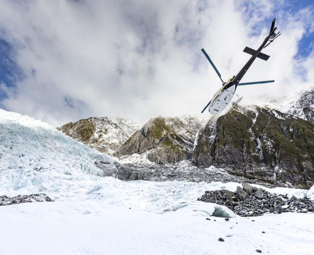Helicopter leaving Franz Josef Glacier. Photo: Getty Images