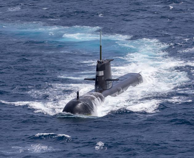 The Royal Australian Navy submarine HMAS Rankin is seen during a maritime exercise between the...