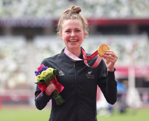 Anna Grimaldi celebrates receiving her gold medal at the Tokyo Paralympics this afternoon. Photo:...