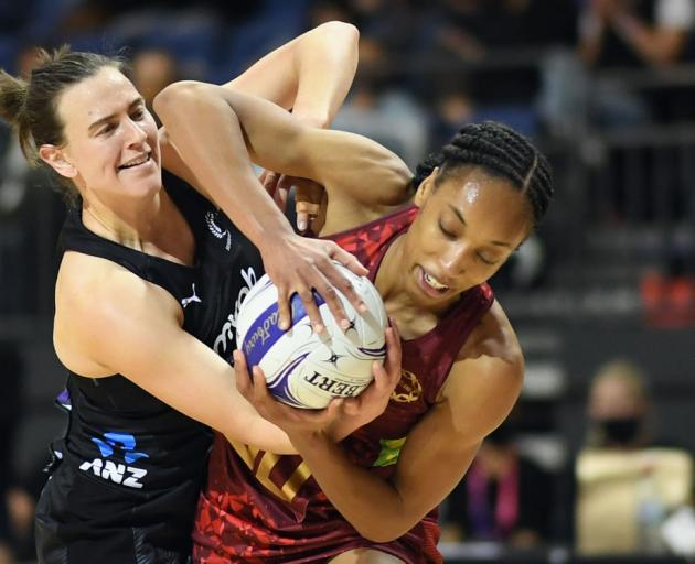 Silver Fern Claire Kersten tries to wrestle the ball from England's Layla Guscoth. Photo: Getty...