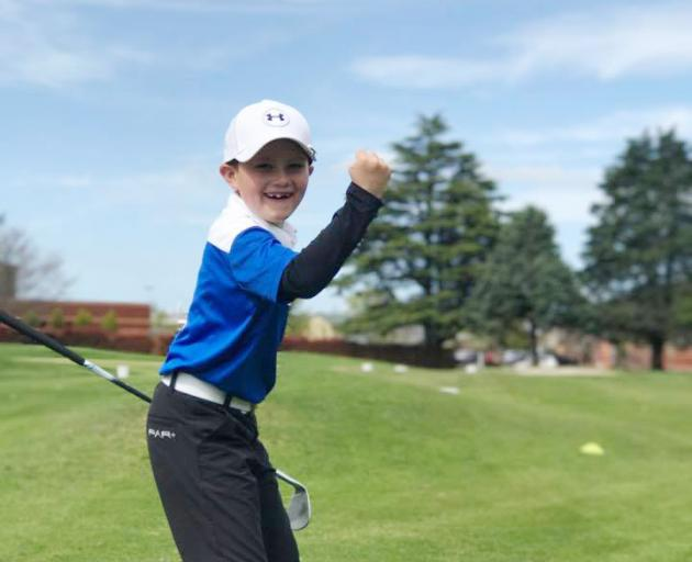 Cooper Moore, seen here celebrating an approach shot as a nine-year-old, has gradually tamed...