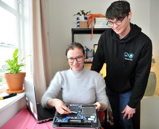Displaying a used laptop that is being refurbished for school pupils are Recycle a Device donor...