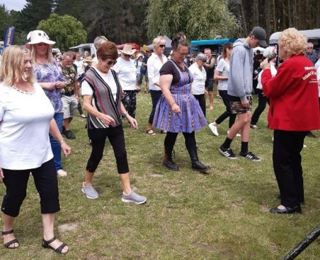 Mary Stanley-Shepherd calls the count during a line dancing session at Spencer Park in 2020....