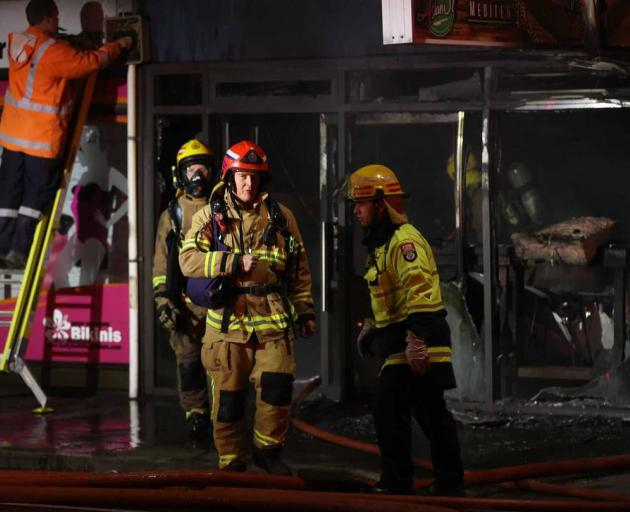 A block of shops on Colombo St has been badly damaged by fire. Photo: George Heard