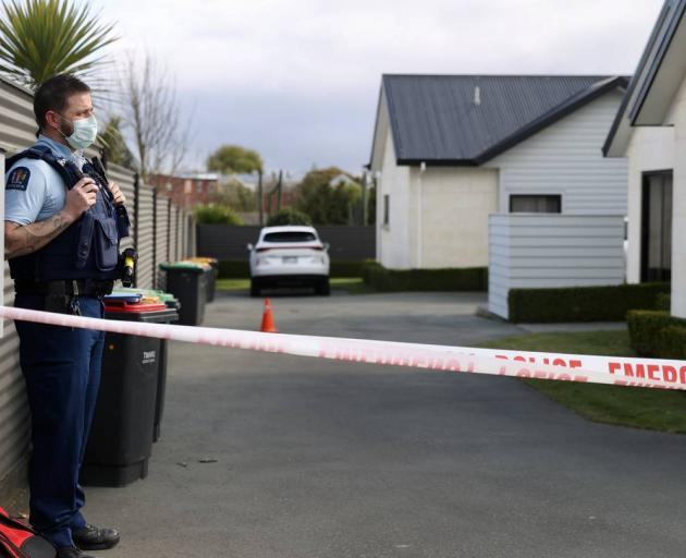 Police stand guard at the scene of the Timaru triple homicide. Photo: George Heard/NZ Herald