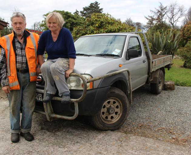 Rob and Sue Green with the vehicle that was entitled to assistance, although the occupants were not. Photo: Greymouth Star