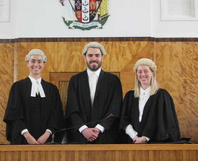 Lawyers (from left) Charlotte Whitaker, William McKenzie and Alisha-May Perkins were admitted to...