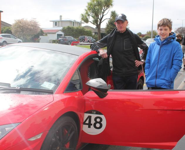 Cromwell man Steve Lyttle shows his Lamborghini to Bede Scully, of Invercargill.