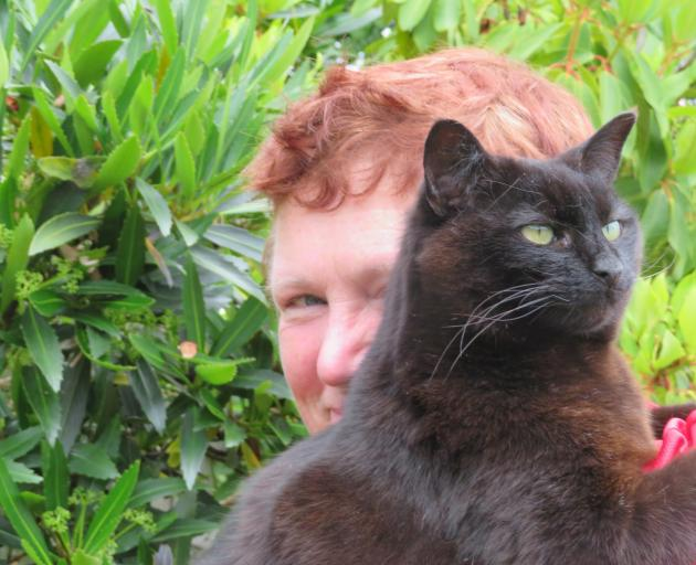 Te Anau resident Sue Peoples with her late cat Jac. PHOTO: SUPPLIED