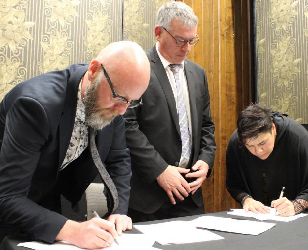 Signing a partnership at Ascot Park Hotel yesterday to deliver a whanau-centred model of primary...