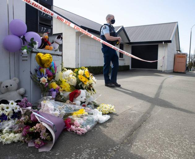The public have begun leaving flowers and teddies outside a Queen St, Timaru house where the bodies of three young sisters were found on Thursday. Photo: George Heard
