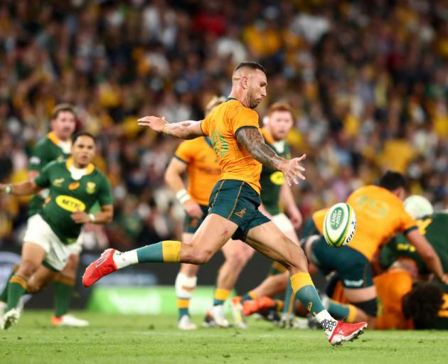 Quade Cooper of the Wallabies kicks the ball through during The Rugby Championship match between the Australian Wallabies and the South Africa Springboks. Photo: Getty Images