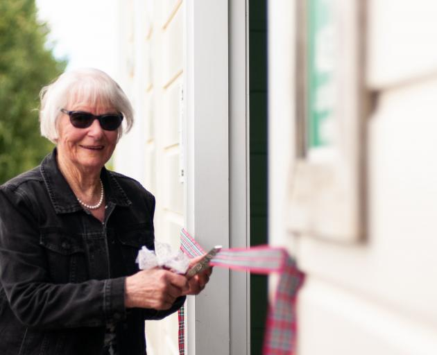 Ruth McNamara cuts the ribbon to officially open the Lauder Railway Station building on Saturday....