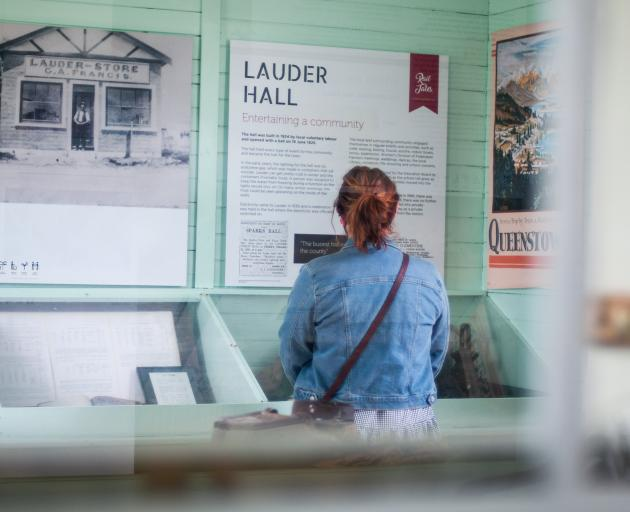 Jess Armstrong, of Heritage NZ, reads history panels in the newly opened Lauder Railway Station.
