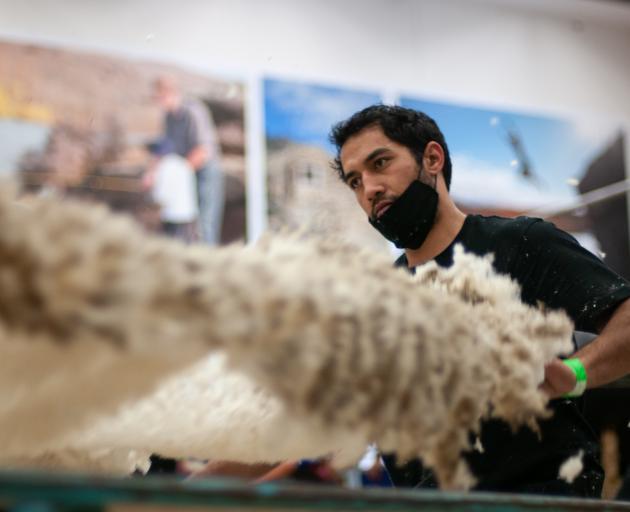 Former World Champion woolhandler Joel Henare regained the New Zealand Merino Shears open...