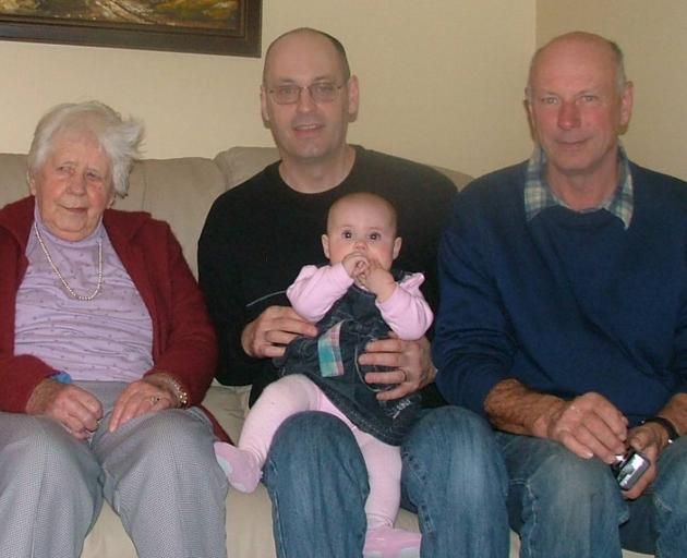 Darin Paterson (middle) with his dad Bruce in a family photo spreading across four generations....