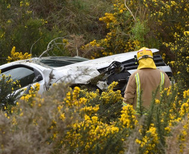 A car crashed down a bank off State Highway 1, north of Dunedin, yesterday. Photo: Gregor Richardson