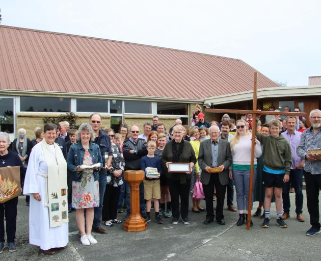 Lumsden Balfour Presbyterian Church members gather outside the Balfour church at the end of a...