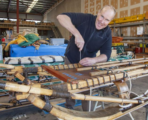 Doug Henderson repairing the old sledges before they head back to the ice for another season....