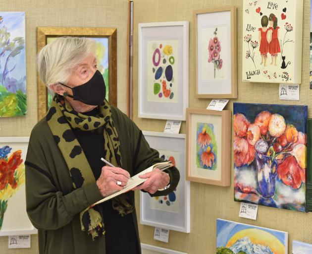 Judging the Green Island Art Group exhibition with a well-trained eye is Otago Art Society vice...