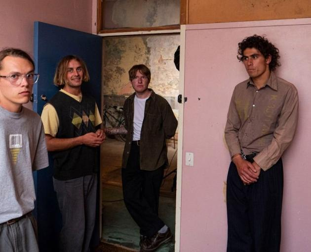 Marlin's Dreaming frontman Semisi Maiai (right) with the band, whose new album is just out. PHOTO...