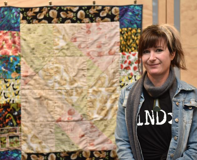 Dunedin autistic artist Tanea Paterson shows her mother's Christmas present, a knee quilt which...