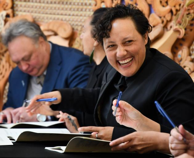 Conservation Minister Kiritapu Allan signs the Southland Aquaculture Agreement in Bluff yesterday...