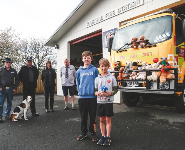 Kakanui brothers Jay (12, front left) and Neiko (8) Thomson donate their Sonic the Hedgehog toy...