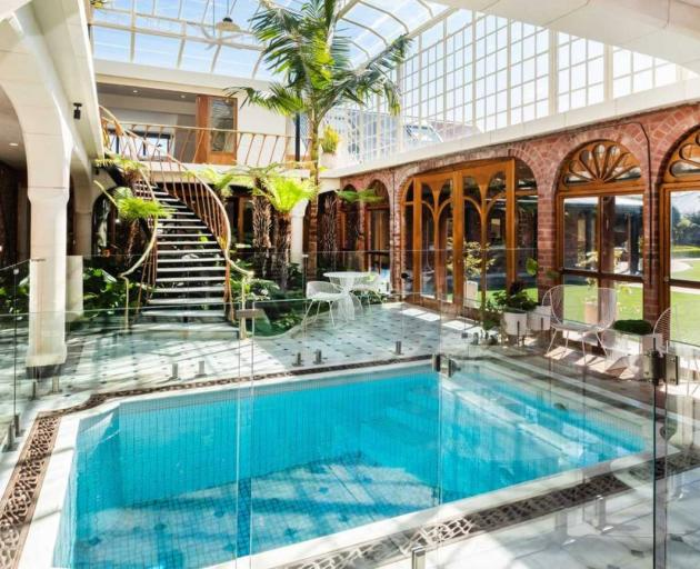 A heated plunge pool sits in the centre of the conservatory. Photo: Supplied